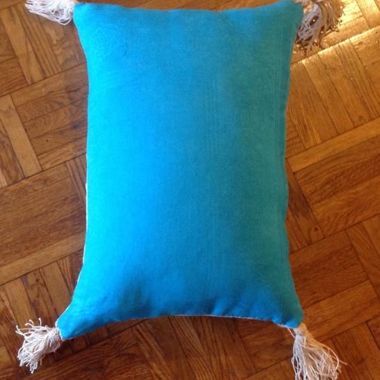 Arriere serviette damassee teinte en bleu turquoise